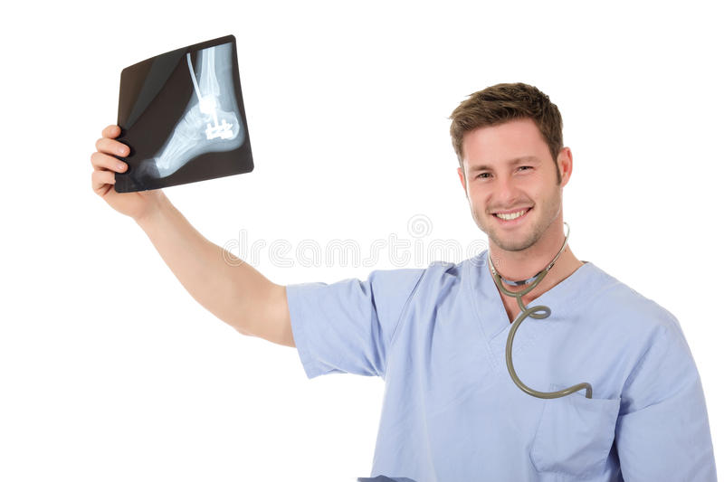 Young successful caucasian man doctor, x-ray. Young successful caucasian man doctor with stethoscope examining x-ray photos. Studio shot. White background royalty free stock images