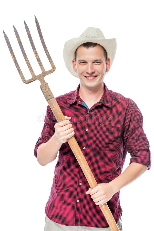 Young successful farmer in a red shirt with pitchforks. Isolated royalty free stock photography