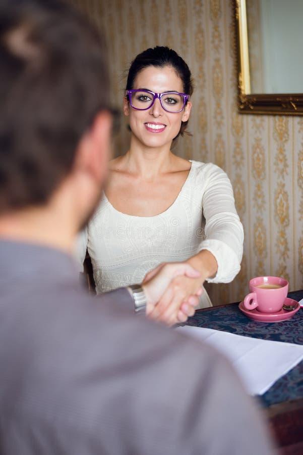 Young successful female entrepreneur handshake royalty free stock image