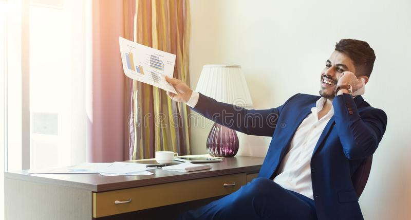 Young successful financier consulting client or partner by smarthone royalty free stock photo