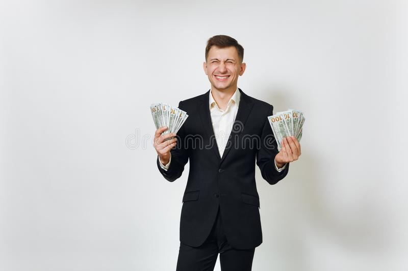 Young successful handsome rich business man in black suit on white background for advertising. royalty free stock photos