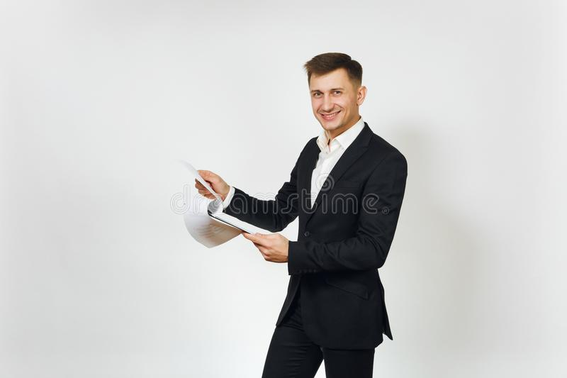 Young successful handsome rich business man in black suit on white background for advertising. royalty free stock photo