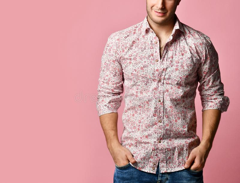Young successful happy smiling business man in shirt standing posing on pink stock images