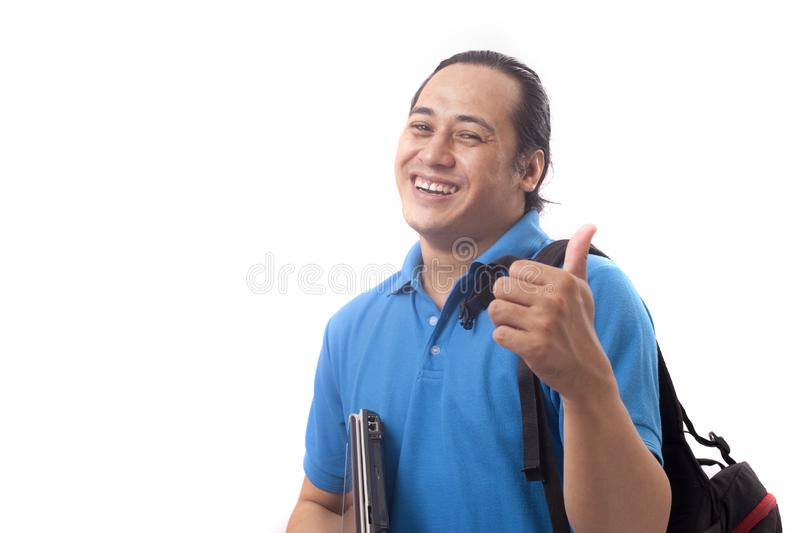 Young Successful Happy Student Shows Thumb Up stock photography