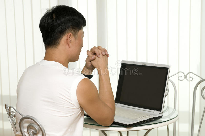 The young successful man with the computer royalty free stock photo
