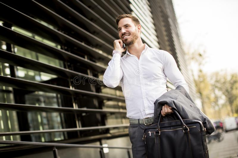 Young successful man executive businessman using his mobile cel royalty free stock photography