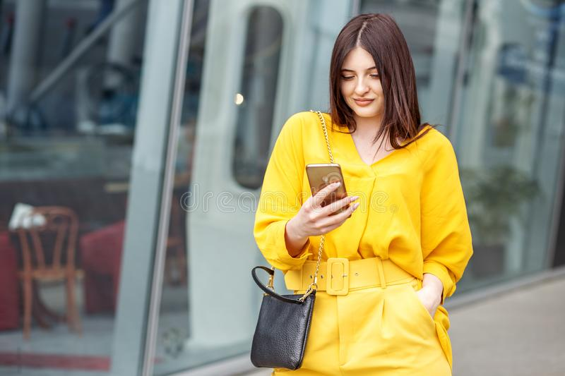 Young successful woman communicates through social networks. Concept for lifestyle, business, technology and fashion royalty free stock photo