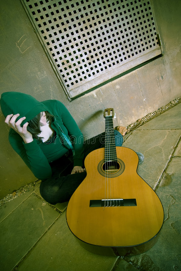 Young suffering guitar performer stock photo