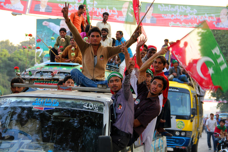 Young Supporter of Imran Khan PTI. LAHORE, PAKISTAN - OCT 30: Enthusiastic Youth going towards the venue Minar-e-Pakistan to attend Imran Khan's political rally royalty free stock photography