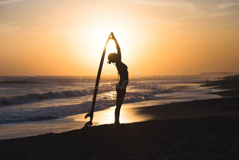Young surfer girl stock photos