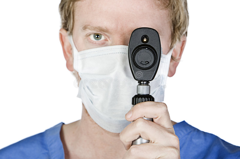 Download Young Surgeon With Mask Holding Light Upto His Eye Stock Image - Image of examine, medical: 8688303