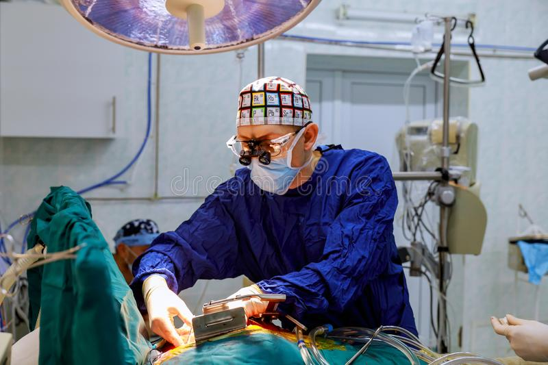 Young surgery team in the operating room stock image