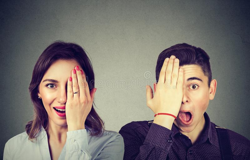 Young surprised couple man and woman looking at camera stock photos
