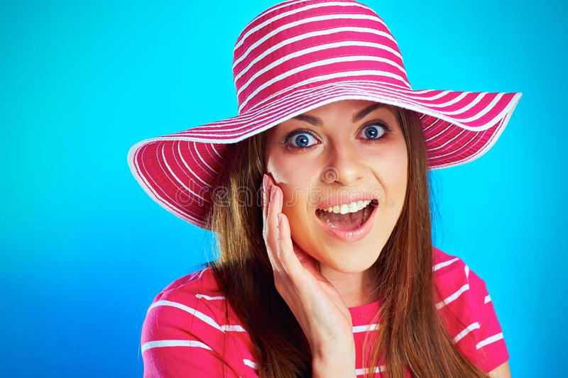 Young surprised smiling woman close up portrait against blue royalty free stock photography