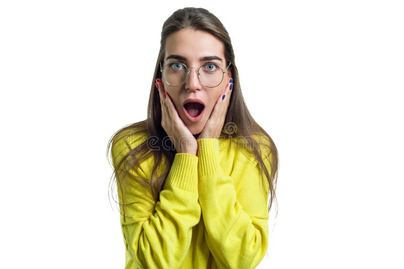 Young surprised woman in glasses yellow clothes on white isolated background royalty free stock photos