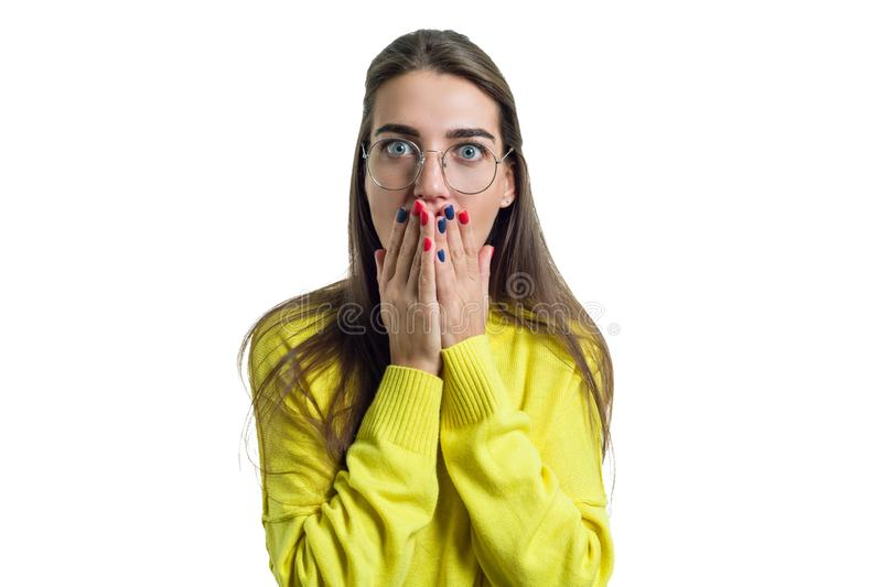 Young surprised woman in glasses yellow clothes on white isolated background royalty free stock photography