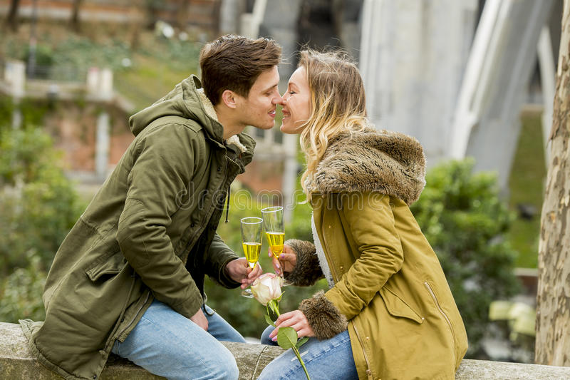 Download Young Sweet Couple In Love Kissing Tenderly On Street Celebrating Valentines Day Or Anniversary Cheering In Champagne Stock Image - Image of happy, attractive: 49640837