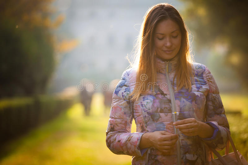 Young sweet woman in love, outdoor backlight. Emotions and femininity. royalty free stock images