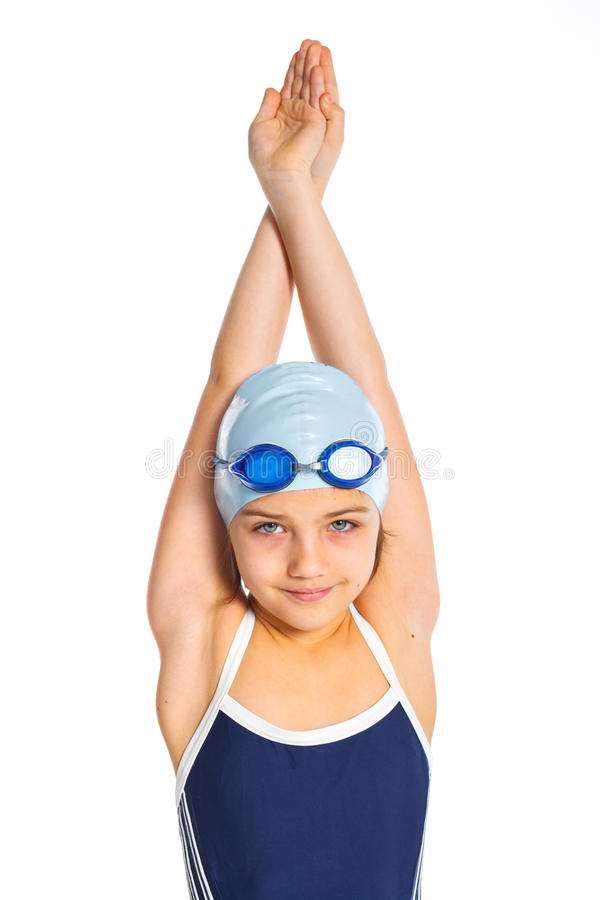 Young swimmer girl. Portrait of a young girl in goggles and swimming cap. Isolated on white background royalty free stock image