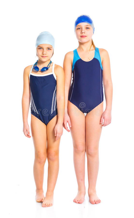 Young swimmer girls. Two young girl in goggles and swimming cap. Isolated on white background stock photos