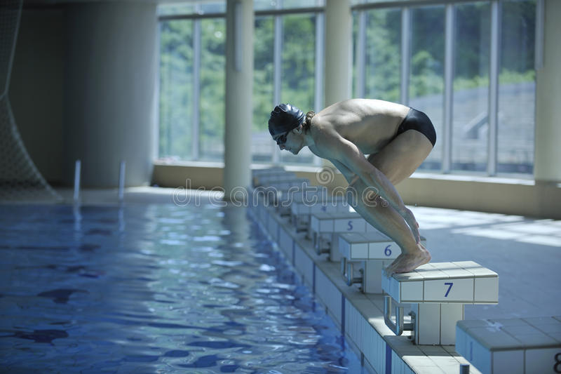 Download Young Swimmer Ready For Start Stock Image - Image: 14442243