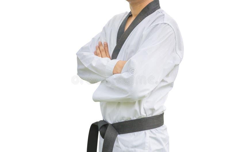 Young taekwondo black belt fighter training Karate posing. Man p royalty free stock photography