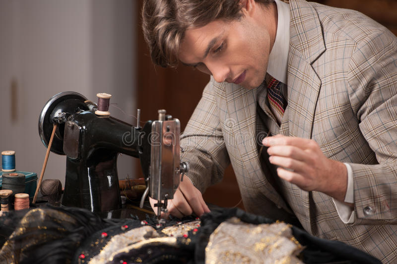 Download Young tailor at work. stock photo. Image of occupation - 33941424