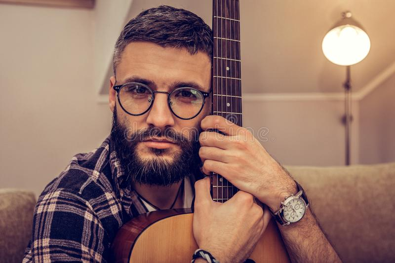 Portrait of a handsome talented young musician stock photos