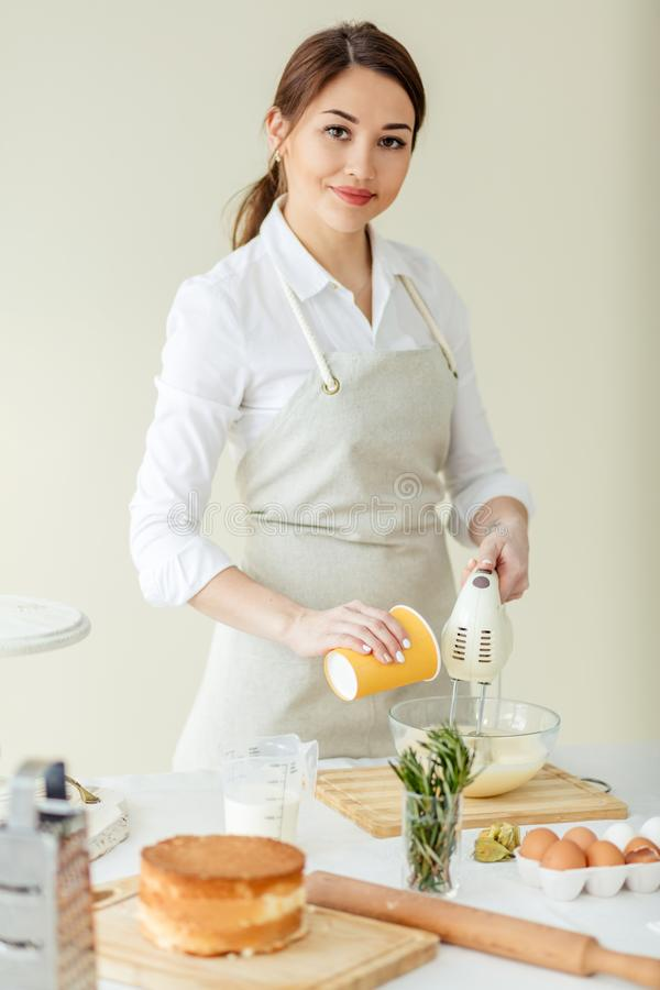 Young talented ambitious girl is good at cooking stock image