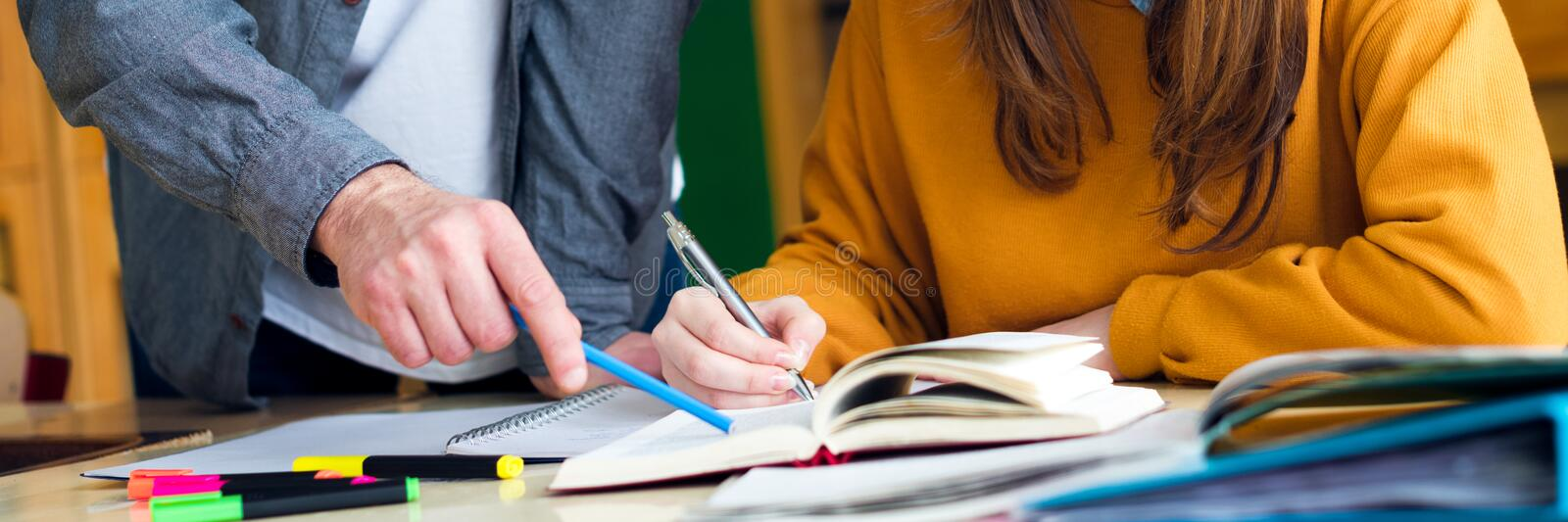 Young teacher helping his student in chemistry class. Education, Tutoring and Encouragement concept. royalty free stock photos
