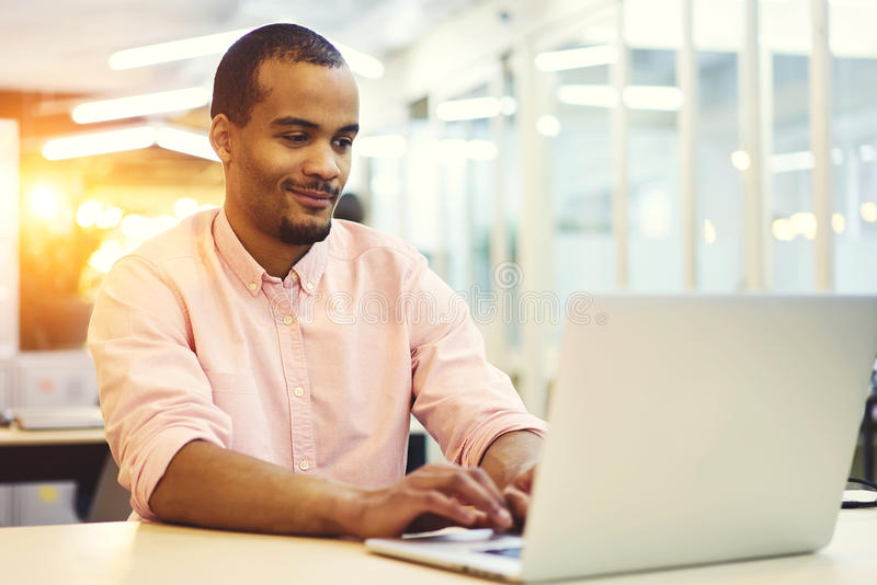 Young teacher and student of followers during online consultation chat working in office indoor in good mood royalty free stock image