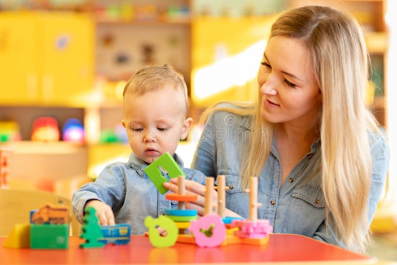 Young teacher studying with baby royalty free stock photography
