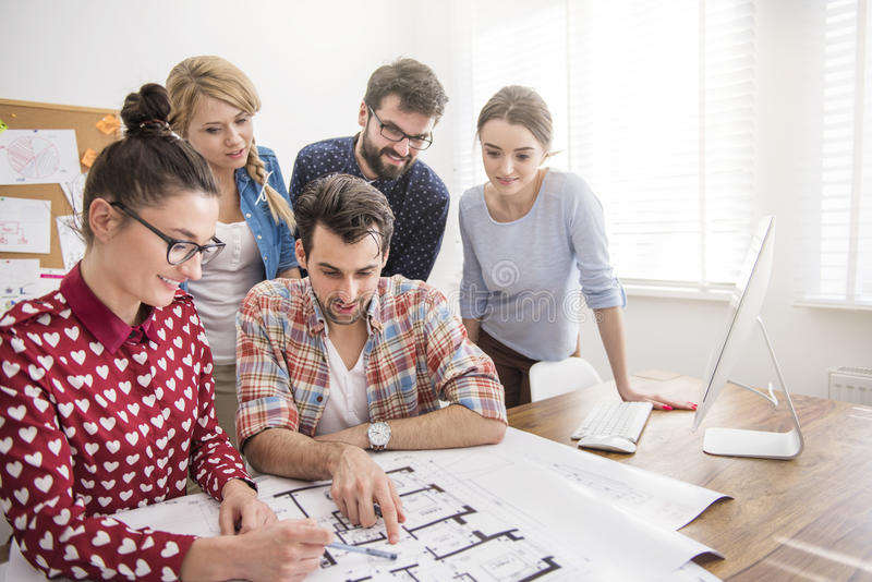 Young team of architects. This project must be finished as soon as possible royalty free stock photos