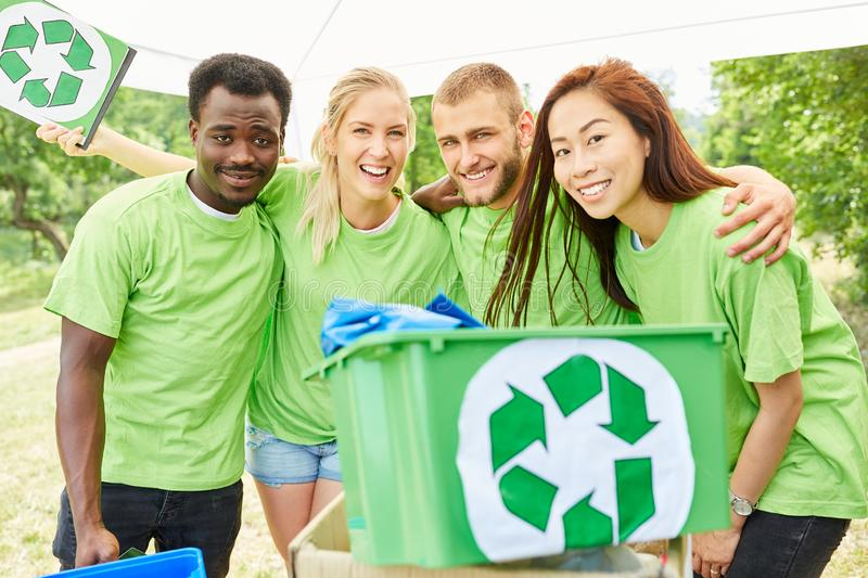 Young team collecting volunteers while garbage. Young people as a team Volunteers collecting garbage in an environmental action stock images