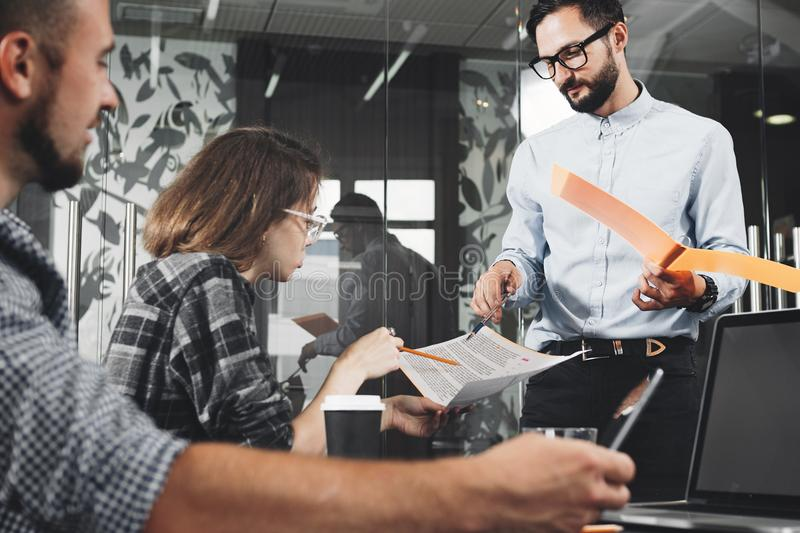 Young team of coworkers business discussion in modern coworking stock images