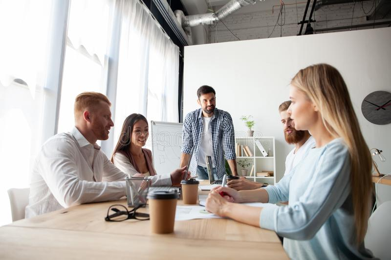 Young team of coworkers making great business discussion in modern coworking office.Teamwork people concept stock image