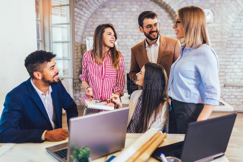 Team of coworkers making great meeting discussion in modern coworking office stock image
