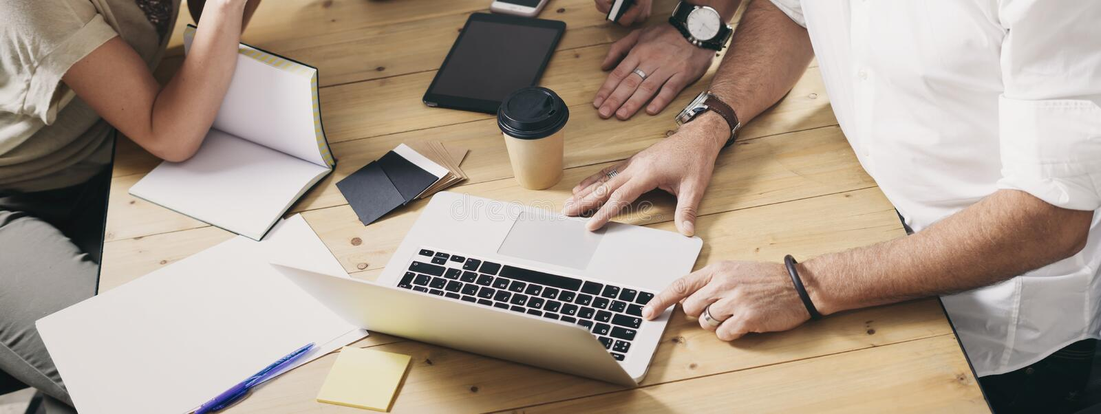 Young team of coworkers making great work discussion in modern office.Business people meeting concept. Wide. royalty free stock photography