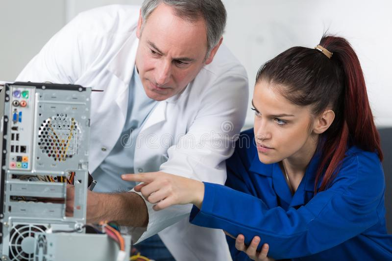 Young technician making observation to supervisor royalty free stock images