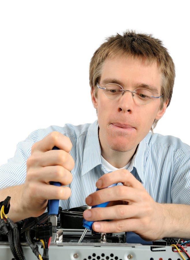 Young technician repairing a PC stock photos