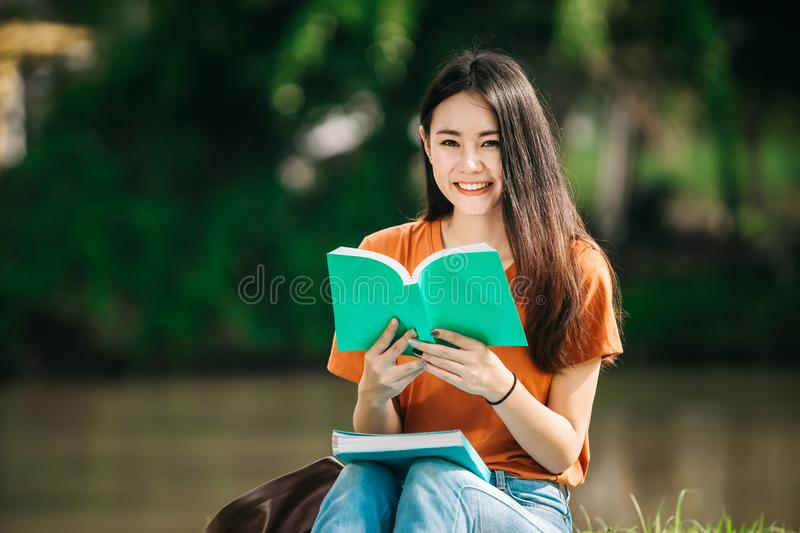 A young or teen asian girl student in university stock images