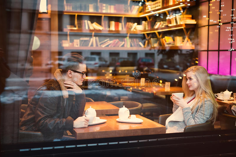 Young teen boy-girl couple, on date gazing into each other royalty free stock images