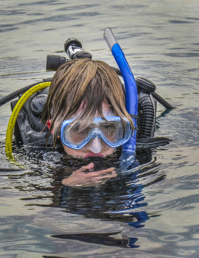 Young Teen Boy - SCUBA Checkout Dive. A young teen boy surfaces during his first open water check out SCUBA dive at Vortex Springs in Florida stock photography