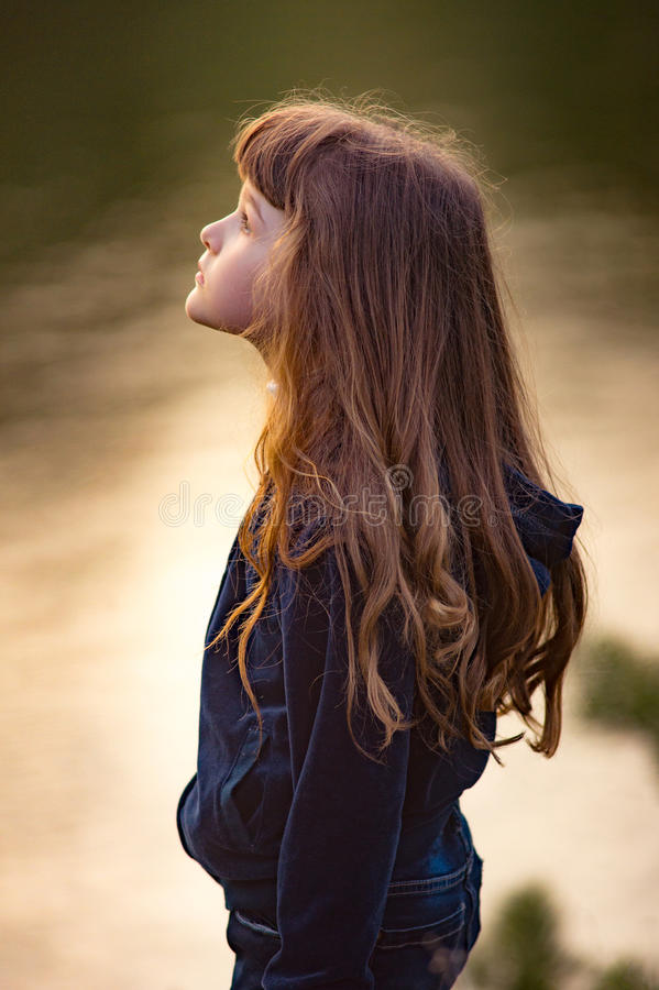 Young teen brunette girl with tears in her eyes with long hair s royalty free stock photos
