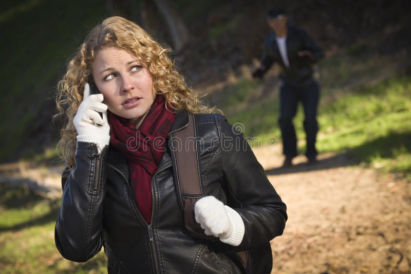 Download Young Teen Girl Walking With Man Lurking Behind Stock Photo - Image of scary, outside: 22192426