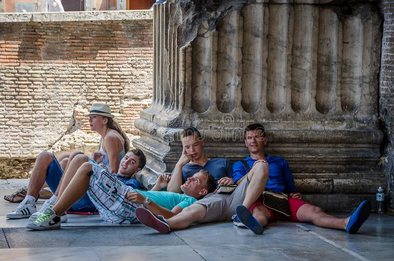 Young teen tourists in the city of Rome. Italy. July 21, 2013 royalty free stock image