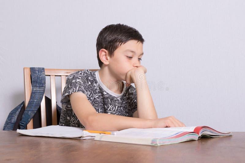 Young teenage boy doing his homework royalty free stock image