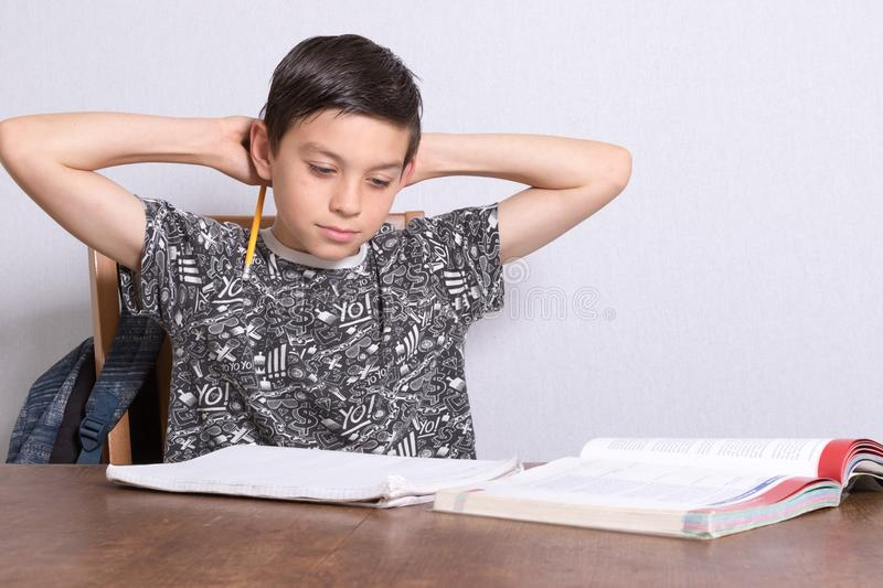 Young teenage boy doing his homework. At home royalty free stock photo