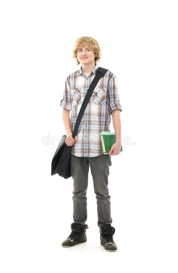A young teenage boy posing in school clothes royalty free stock photos