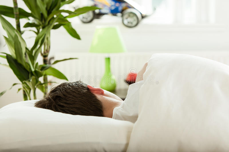 Young teenage boy sleep in his bedroom royalty free stock images